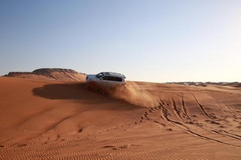 Dubai: Rode Duin-safari met quad bike, sandboard & kamelen