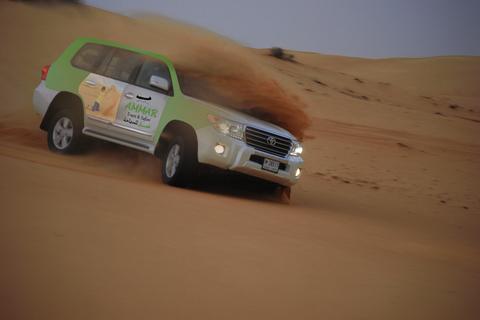 Dubai: safari Red Dunes met bbq, kameelrijden & sandboarding