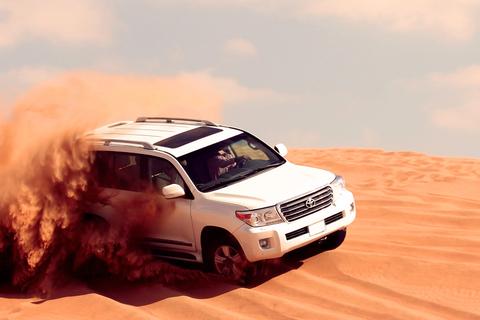 Dubai: ochtendsafari met quads, sandboarden & kamelenrit