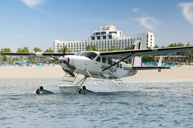 Zonsopgang boven Dubai per watervliegtuig + abra over de Dubai Creek + stadstour